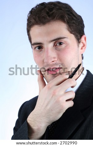 Unshaven white-collar worker with pen. Close-up over sky-blue background