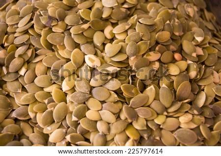 unshelled green pumpkin seeds texture close up - stock photo