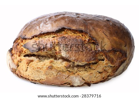 Unsliced rye bread on bright background