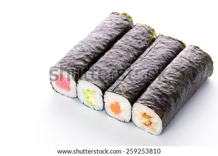 Unsliced sushi maki isolated on white background - stock photo