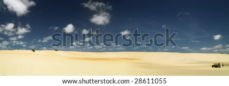 Unspoiled beautiful dunes of genipabu against a deep blue sky with white clouds, Natal. brazil