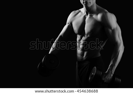 Unstoppable on the way to his goal. Cropped black and white shot of a professional  muscular bodybuilder pumping iron shirtless copyspace on the side - stock photo