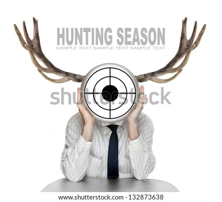Unsuccessful manager (politician, boss, worker, etc) with shooting target and great antlers. Funny picture from the office. - stock photo
