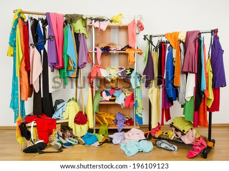 Untidy Cluttered Woman Wardrobe With Colorful Clothes And Accessories Messy Thrown On A Shelf