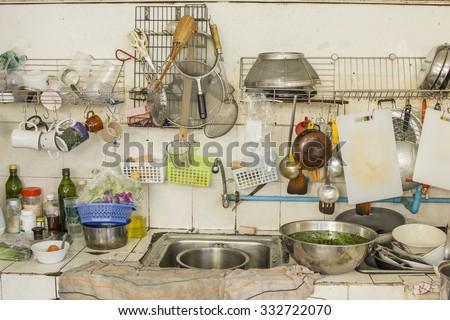 untidy Kitchenware in the kitchen - stock photo