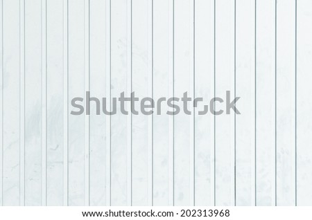 untidy white metal wall with straight vertical grooves - stock photo