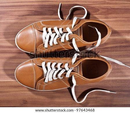 untied shoes - stock photo