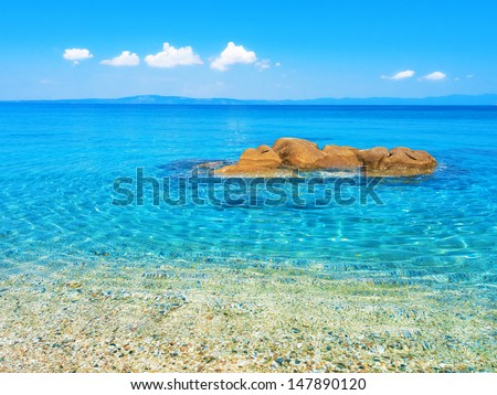 Untouched nature abstract archipelago in seashore with rocks in water in peninsula Halkidiki , Greece - stock photo