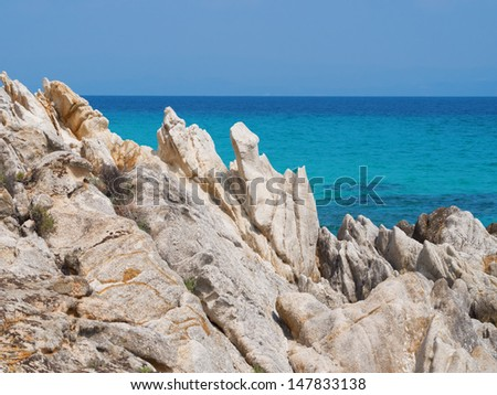 Untouched nature abstract archipelago in seashore with rocks in water on peninsula Halkidiki, Athos, Greece  - stock photo