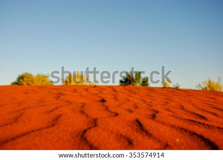 untouched red sand dune at sunset on Lasseter Highway near - Kata Tjuta National Park in Central Australia - stock photo