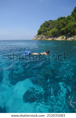 Untouched tropical sea with corals and swimmer in Phang Nga Province, Thailand : Koh Ta Chai