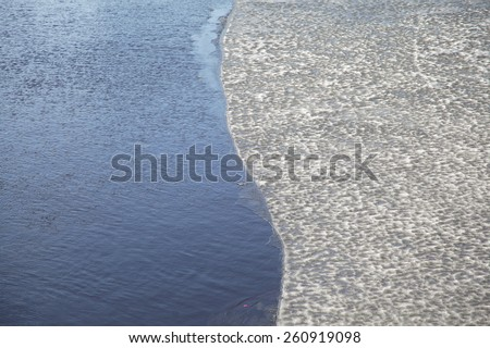 Unusual abstract ice and water background - stock photo