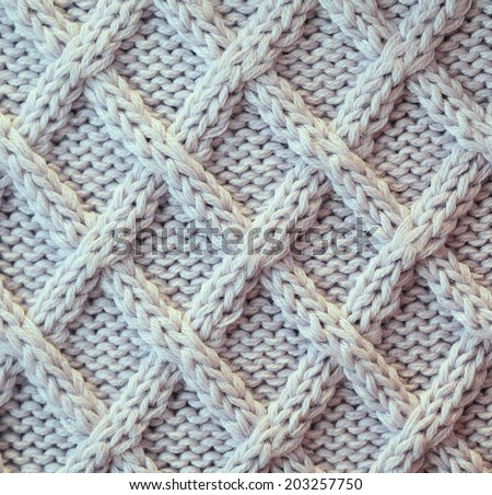 Unusual Abstract light grey knitted pattern background texture - stock photo