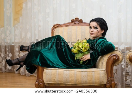Unusual beautiful bride in a green dress - stock photo