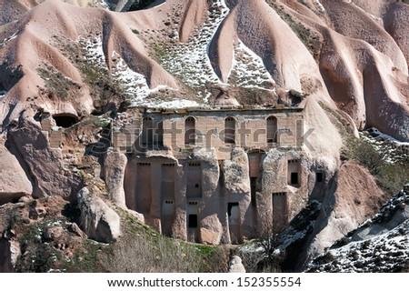 Unusual building in rocks of Cappadocia, Turkey - stock photo