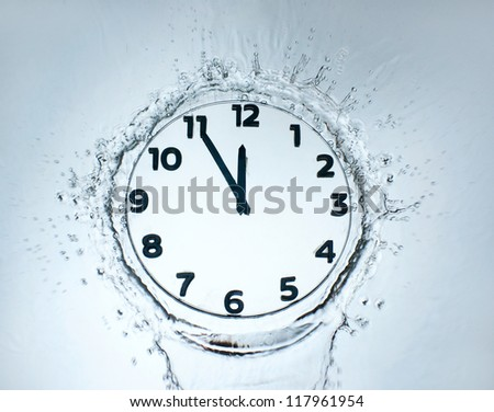 Unusual design clock with water - stock photo