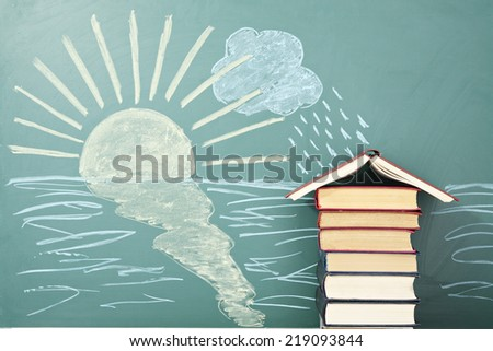 Unusual education concept. School from books on background of chalk drawing of sun and rain. - stock photo