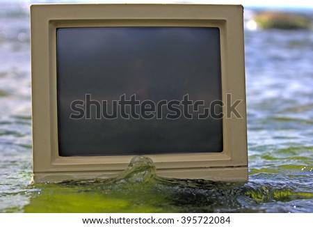 unusual frame sea surrounds computer monitor - stock photo