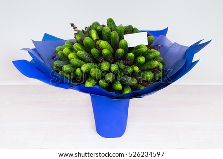Unusual gift for a guy. The concept of edible bouquet consisting of Cucumber