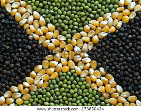 Unusual Jamaica flag made of food and condiments - stock photo