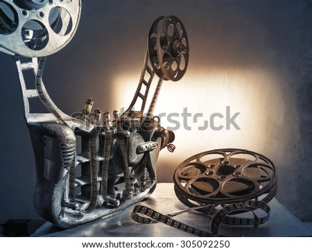 Unusual, old film projector with reels of film - stock photo