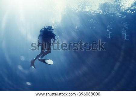 unusual photo diver underwater background - stock photo