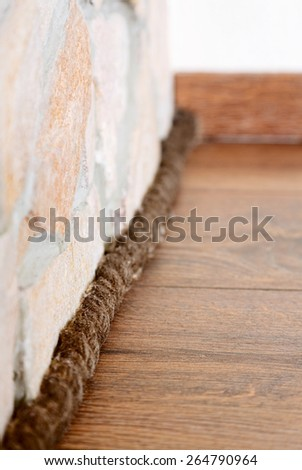 Unusual plinth made from rope, interior decoration detail - stock photo