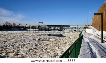 Unusual site where the Grand River is iced over. - stock photo