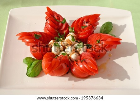 Unusually styled caprese salad with mozzarella cheese, tomatoes and basil - stock photo