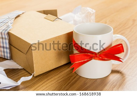 Unwanted gift, cup - stock photo