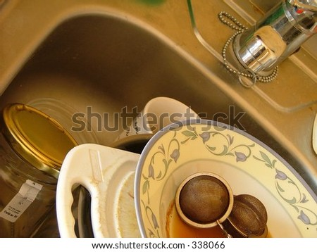 unwashed dishes in the sink - stock photo