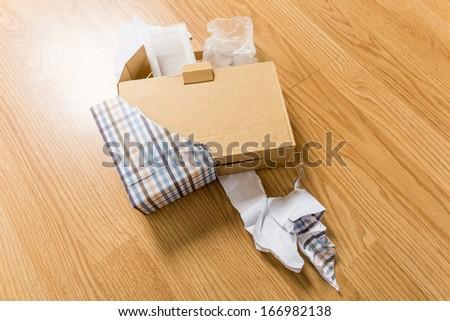 Unwrap of present - stock photo