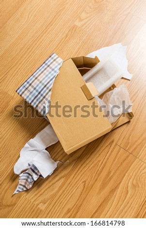 Unwrapped and opened gift box - stock photo