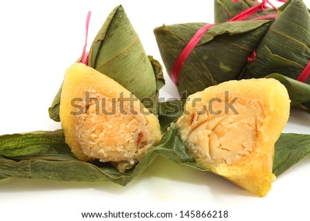 Unwrapped Chinese Rice Dumplings cut in half isolated on white - stock photo