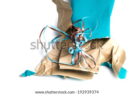Unwrapped wrapping paper and ribbon - stock photo