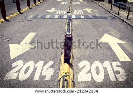 Up and down arrow signs on the road with next and passed year  - stock photo