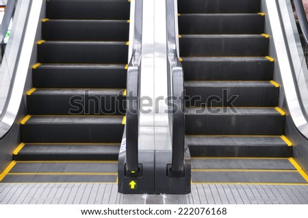 Up and down escalators in public building. - stock photo