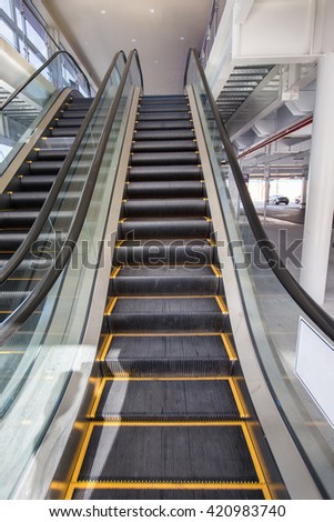 Up and down escalators in public building. Indoors