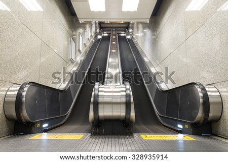 Up and down escalators in the building - stock photo
