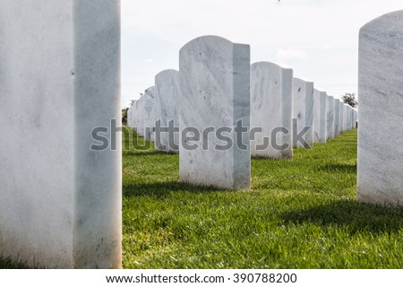 Up-close view of rows of headstones at Miramar National Cemetery in San Diego, California.