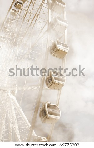 Up In The Clouds Of Distant Dreams A Ferris Wheel Spins In The Show Grounds Of The Faraway Fair - stock photo