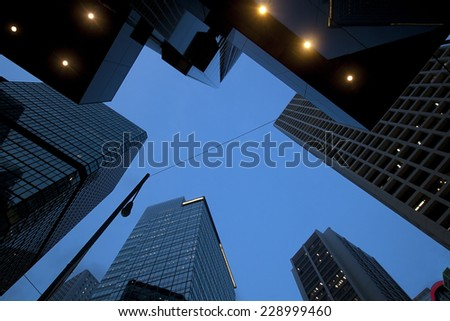 Up view to scyscapers in Hong Kong, Central district, business downtown in a twilight - stock photo