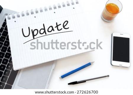 Update - handwritten text in a notebook on a desk - 3d render illustration. - stock photo