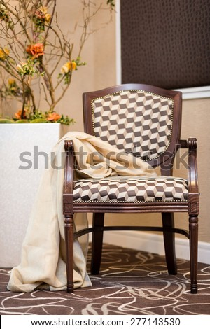 Upholstered stylish wooden chair in brown/beige color - stock photo