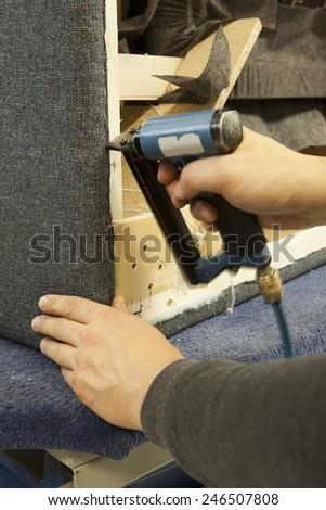 upholstery gun, stapler - stock photo