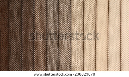 Upholstery textile materials variety shades of brown - stock photo