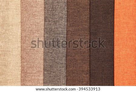 Upholstery textile materials variety shades of brown and orange