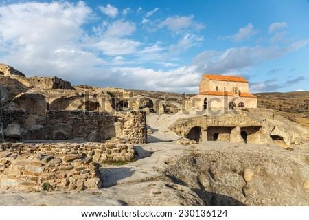 Uplistsikhe, an ancient rock-hewn town near Gori in Georgia - stock photo