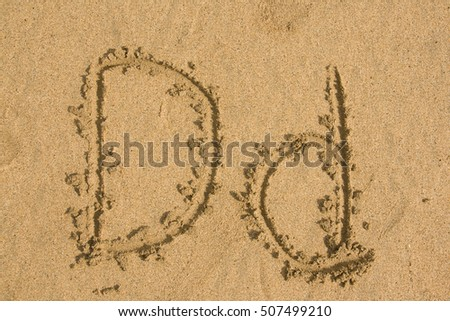Upper and lower case letter D written in the sand