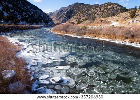 Upper Arkansas River in the Rocky Mountains of Colorado. Winter, ice floats on water - stock photo